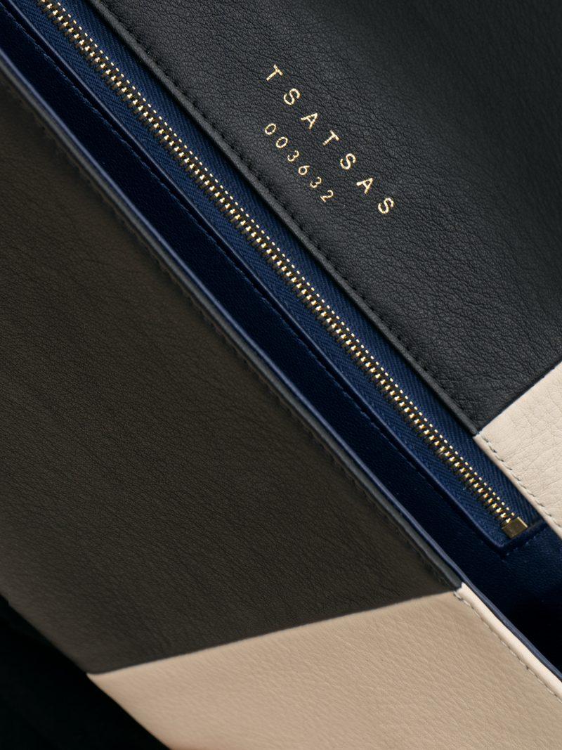 HAZE clutch bag in black/ivory calfskin leather | TSATSAS