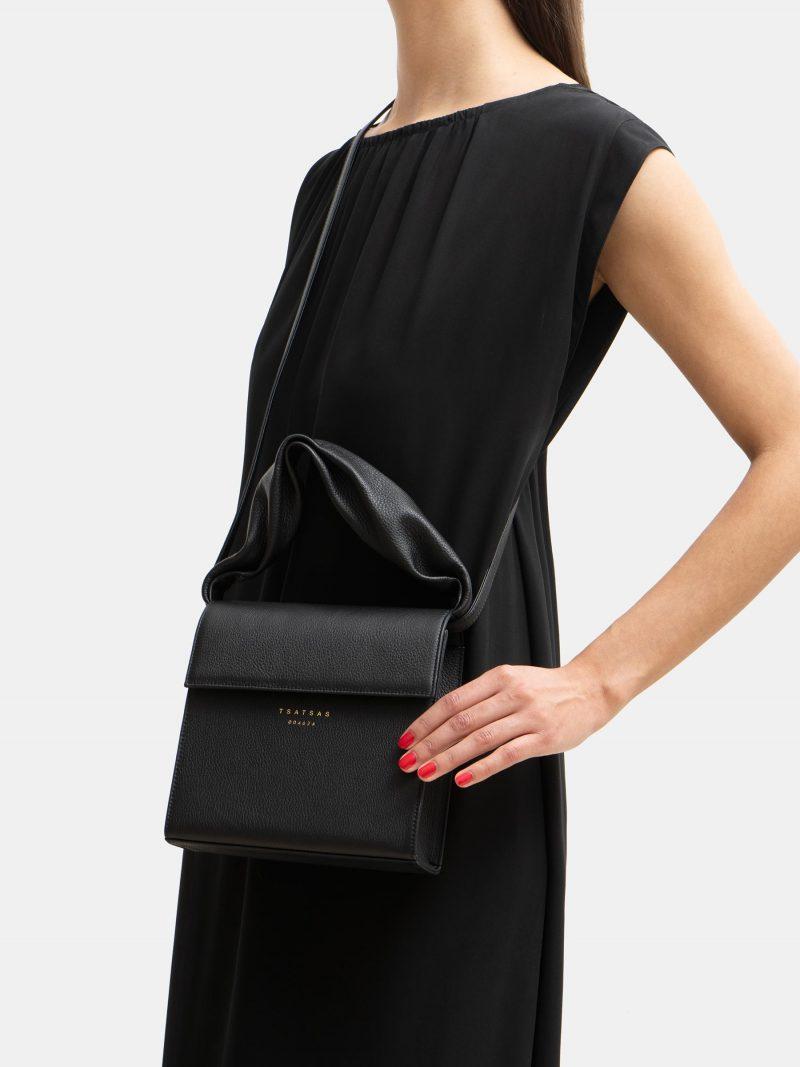 RHEI top handle bag in black calfskin leather | TSATSAS